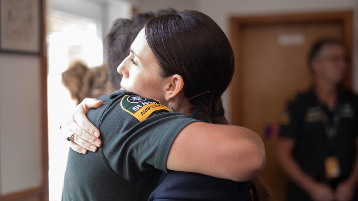 PM Jacinda Ardern met with first responders to the NZ volcano. (AFP)