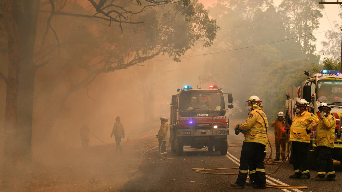 Firefighters conduct back-burning measures to secure residential areas from encroaching bushfires in the Central Coast, some 90-110 kilometres north of Sydney on December 10, 2019. (AFP)