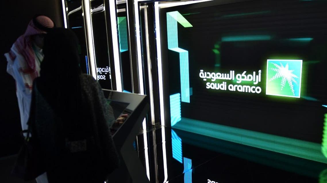 November 13, 2019, visitors stop at the Aramco exhibition section at the Misk Global Forum on innovation and technology held in Riyadh. Credit AFP