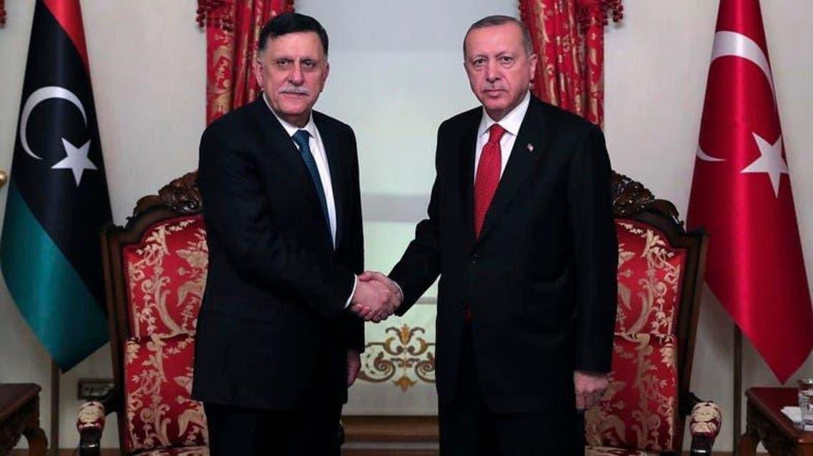 Fayez al-Sarraj, whose retinue were reportedly in clashes, with Turkey's President Recep Tayyip Erdogan on November 27, 2019. (AP)