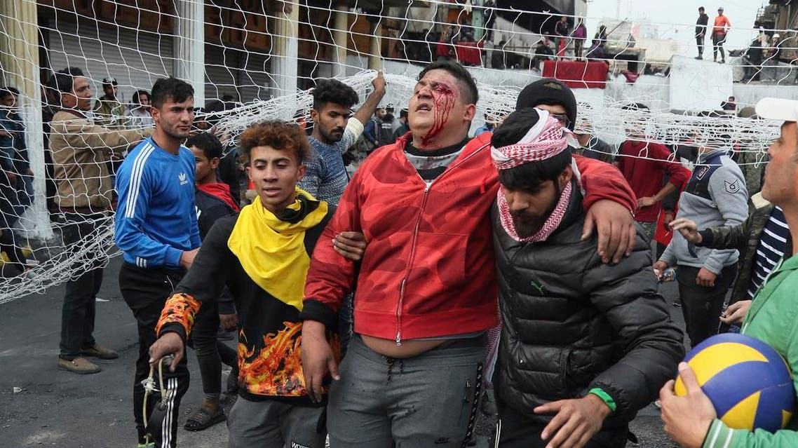 Protesters evacuate an injured protester during minor clashes with Iraqi riot police at a bridge in Baghdad, Iraq, Tuesday, Dec. 10, 2019. (AP)