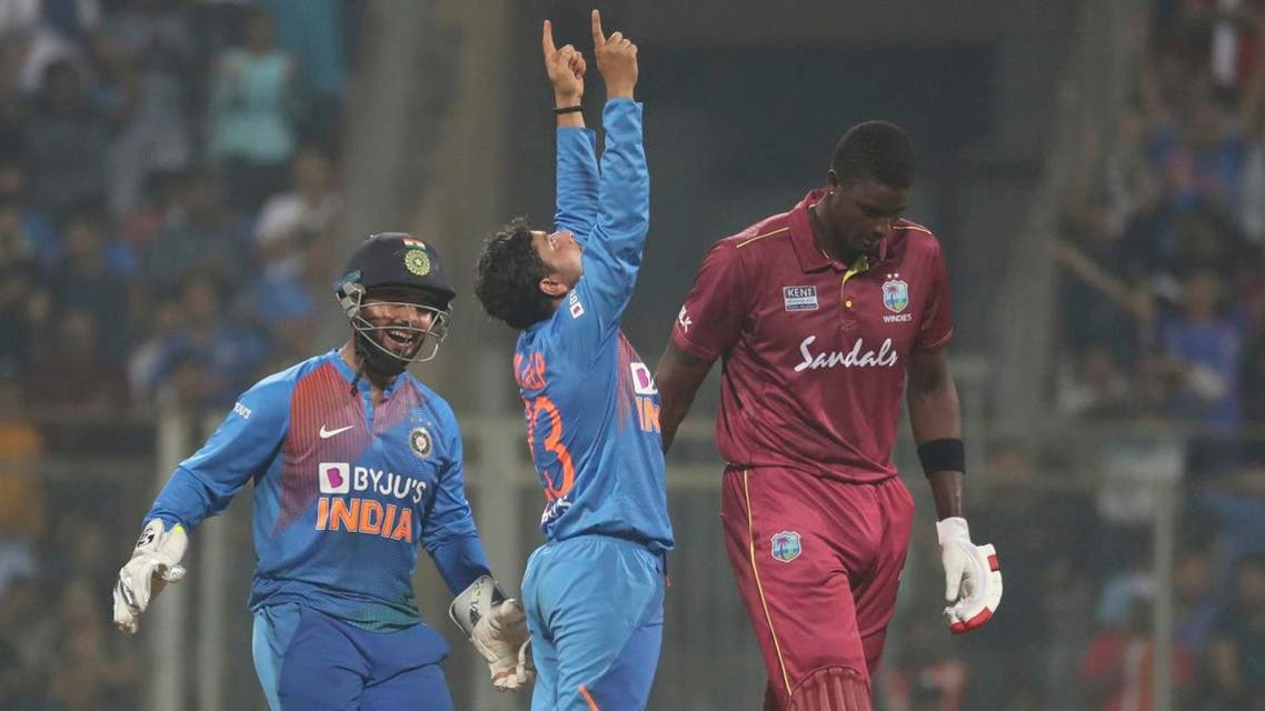 India's Kuldeep Yadav (center), celebrates the dismissal of West Indies Jason Holder during the third Twenty20 international cricket match between India and West Indies in Mumbai, India, on December 11, 2019. (AP)
