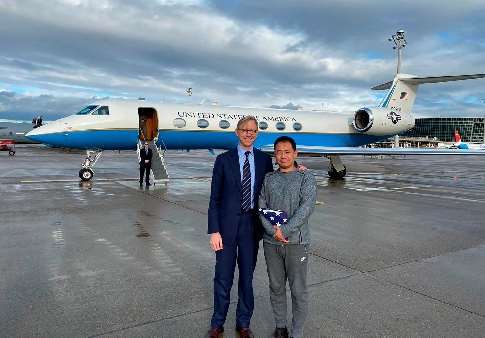 U.S. special representative for Iran, Brian Hook stands with Xiyue Wang in Zurich, Switzerland on Saturday, Dec. 7, 2019. (AP)
