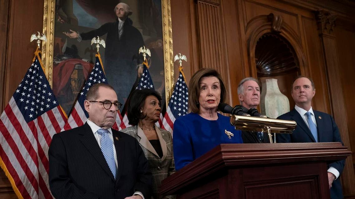 Speaker of the House Nancy Pelosi, D-California, unveils articles of impeachment against President Donald Trump, abuse of power and obstruction of Congress, at the Capitol in Washington, on December 10, 2019. (AP)