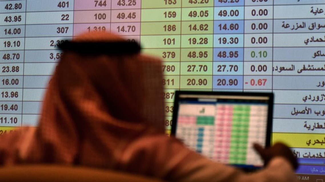 A Saudi broker monitors the stock market at the Arab National Bank in the Saudi capital Riyadh. (File photo: AFP)