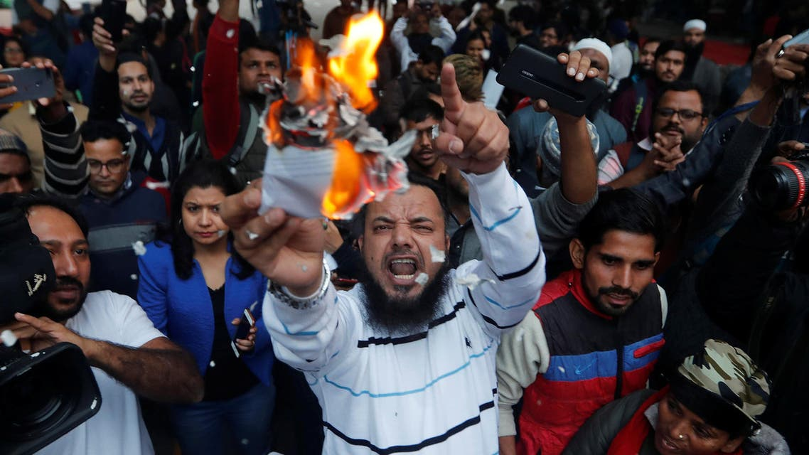 Demonstrators burn copies of Citizenship Amendment Bill, a bill that seeks to give citizenship to religious minorities persecuted in neighbouring Muslim countries, during a protest in New Delhi, India, December 10, 2019. REUTERS