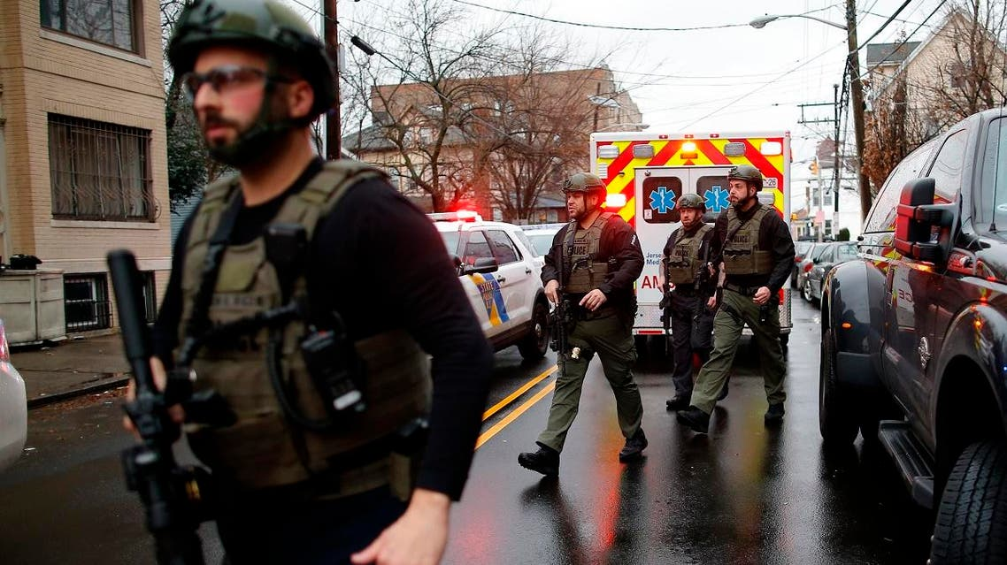 Police officers arrive at the scene following reports of gunfire, on December 10, 2019, in Jersey City, New Jersey. (AP)