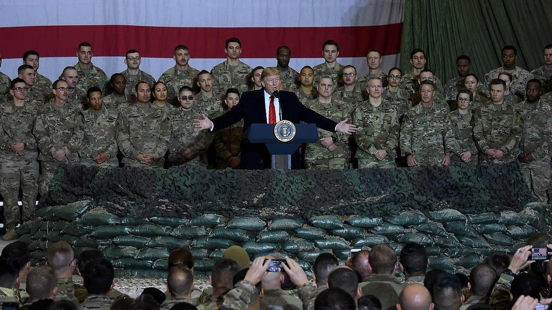 US President Donald Trump speaks to the troops during a surprise Thanksgiving day visit at Bagram Air Field, on November 28, 2019 in Afghanistan. (AFP)