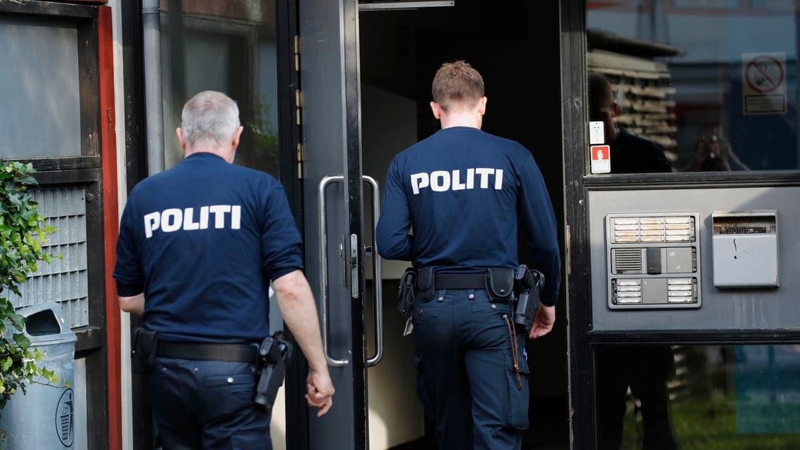 Police officers walk outside an apartment building cordoned off, in Brondby Strand, Copenhagen, Denmark, Thursday, Sept. 21, 2017.  (AP)
