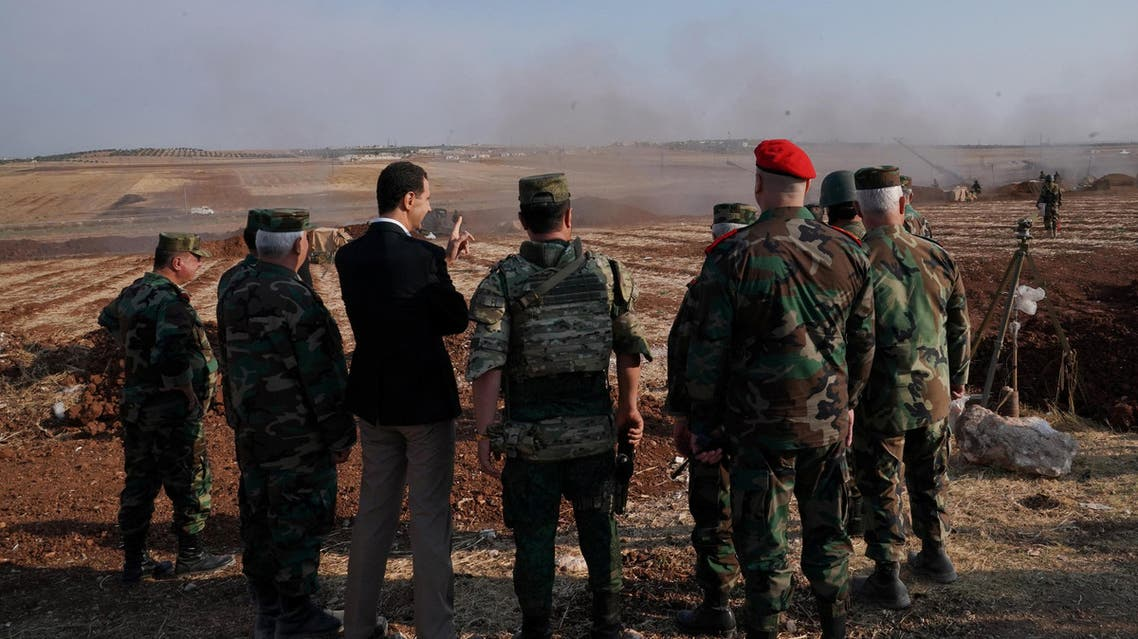 Assad visits troops in Syria Idlib October 22, handout by SANA, Reuters