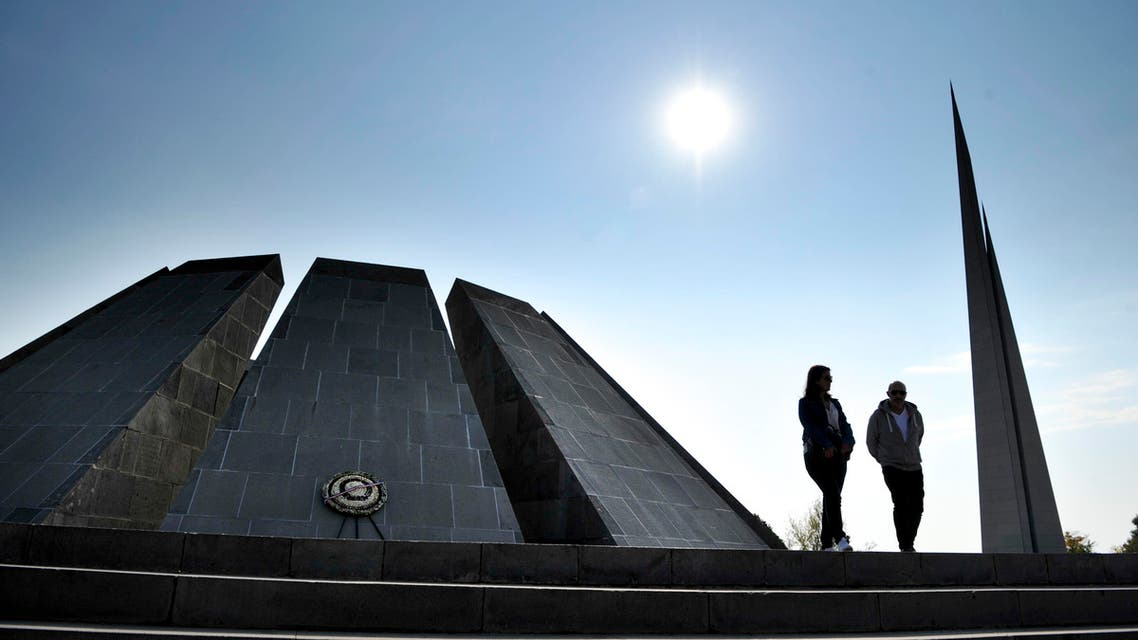A couple walk at the Tzitzernakaberd memorial to the victims of mass killings by Ottoman Turks, in the Armenian capital Yerevan, Armenia, Wednesday, Oct. 30, 2019. (AP)