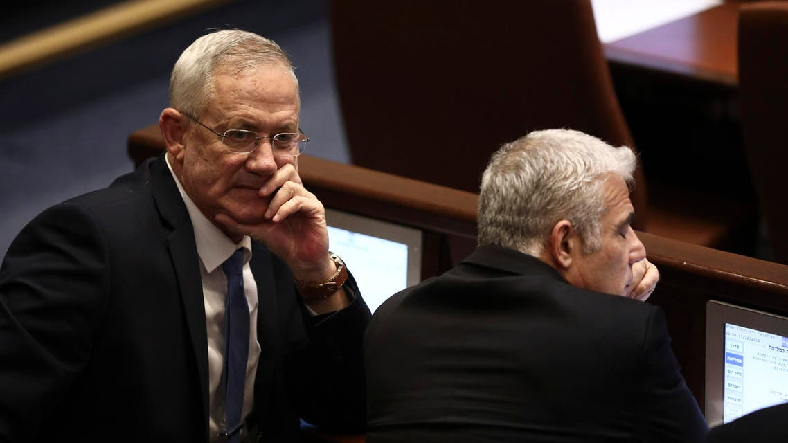 Blue and White party leaders Benny Gantz, left, and Yair Lapid attend a Knesset session in Jerusalem, Wednesday, Dec. 11, 2019. (AP)