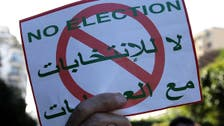 Algeria holds presidential election as thousands demonstrate against vote