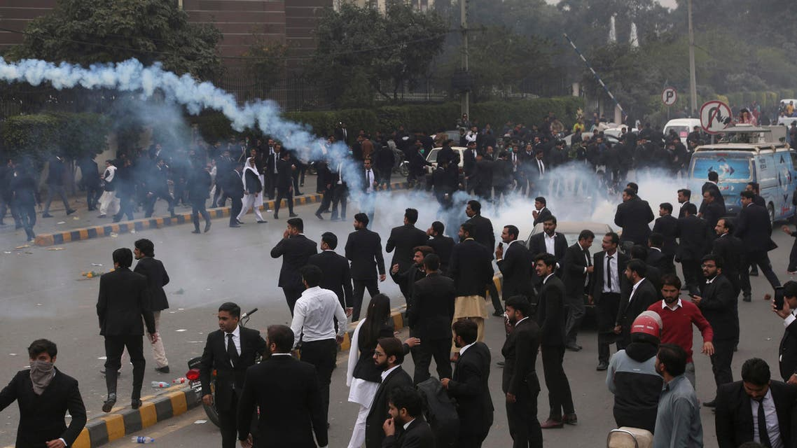 Lahore lawyers attack hospital in Pakistan tear gas December 12, 2019 - AP