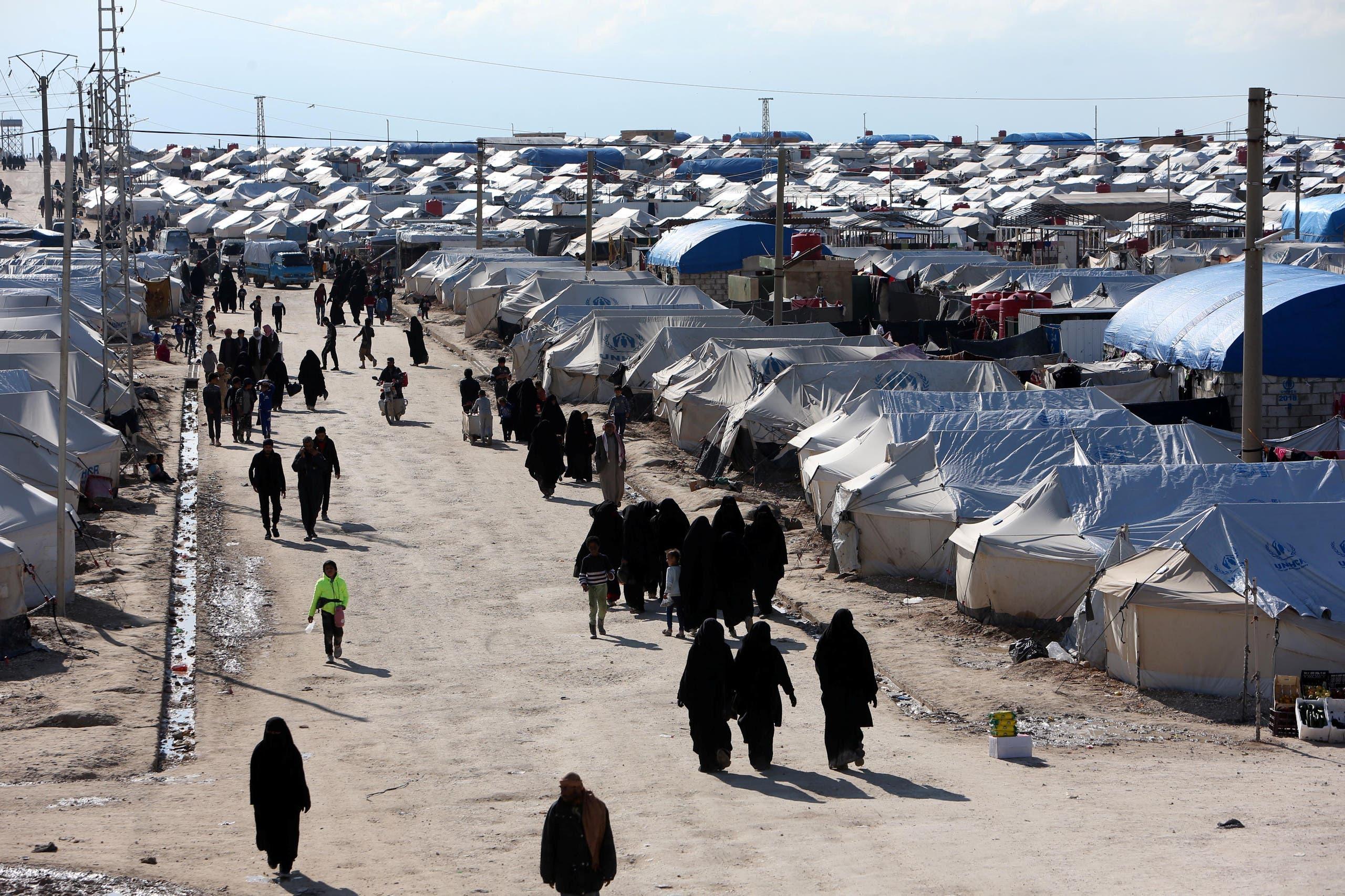 Women walk through al-Hol displacement camp in Hasaka governorate, Syria April 1, 2019. (Reuters)
