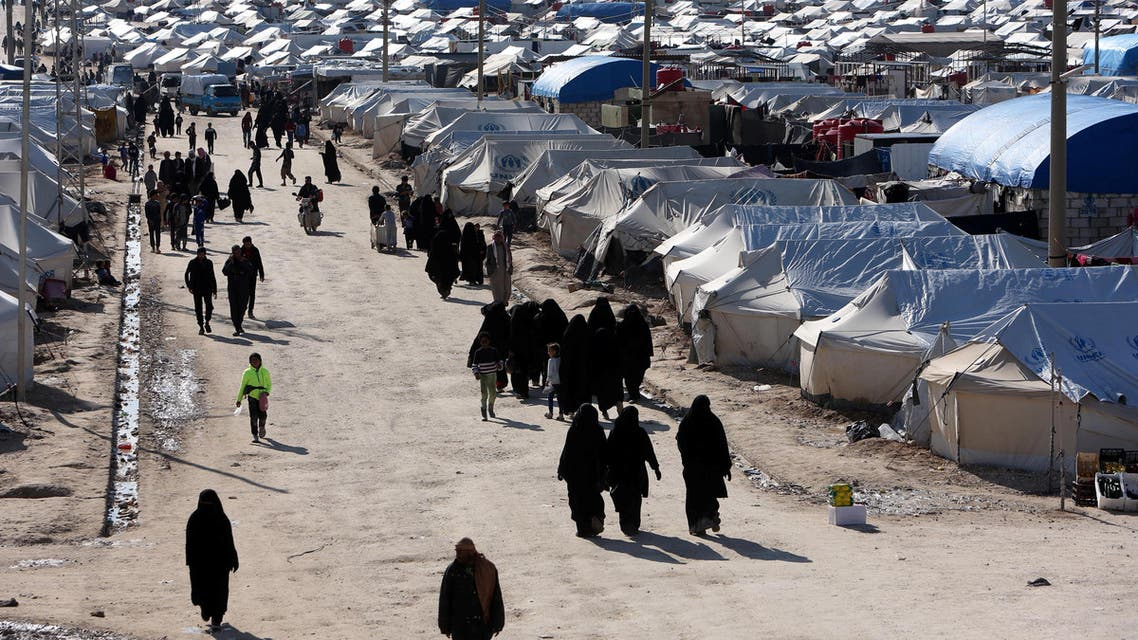 Women walk through al-Hol displacement camp in Hasaka governorate, Syria April 1, 2019. REUTERS