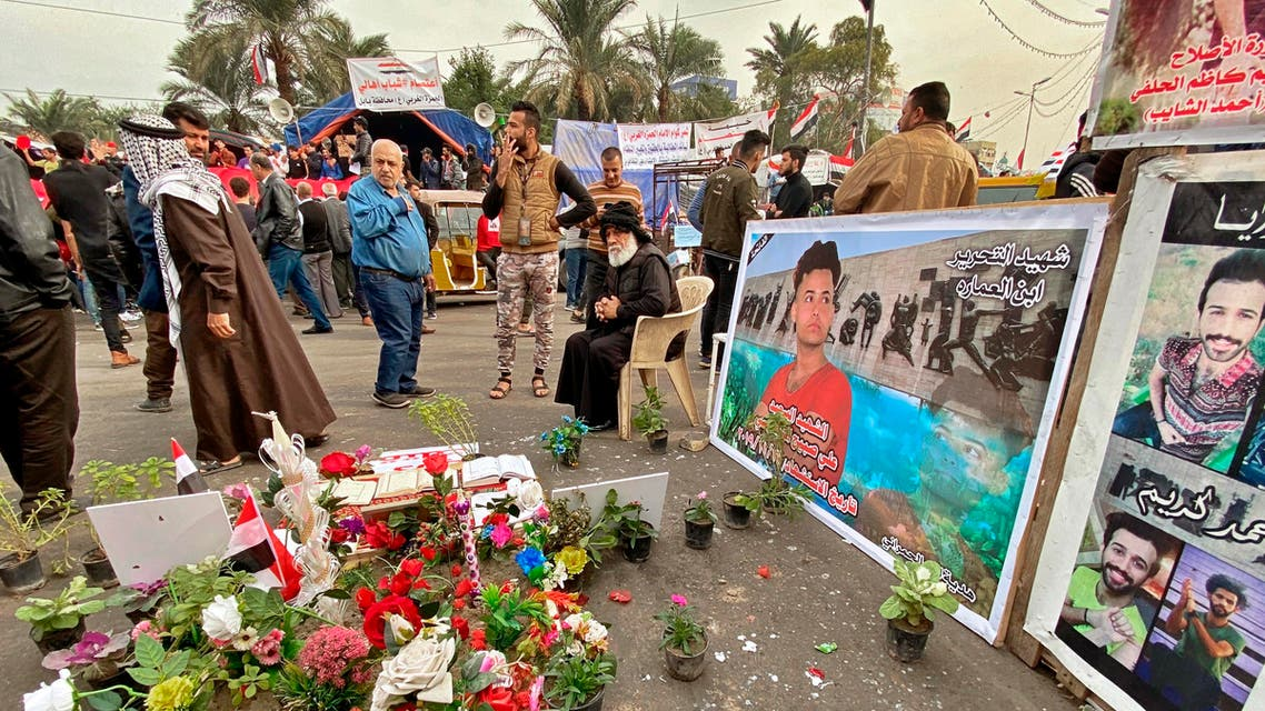 Posters of Anti-government protesters who have been killed in demonstrations are displayed in Tahrir Square during ongoing protests in Baghdad, Iraq, Thursday, Dec. 12, 2019. (AP Photo)