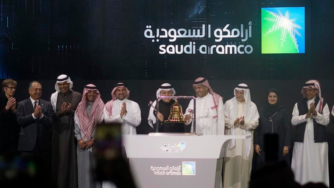 Saudi Arabia's state-owned oil company Saudi Armco and stock market officials celebrate during the official ceremony marking the debut of Aramco's IPO. (File photo: AP)