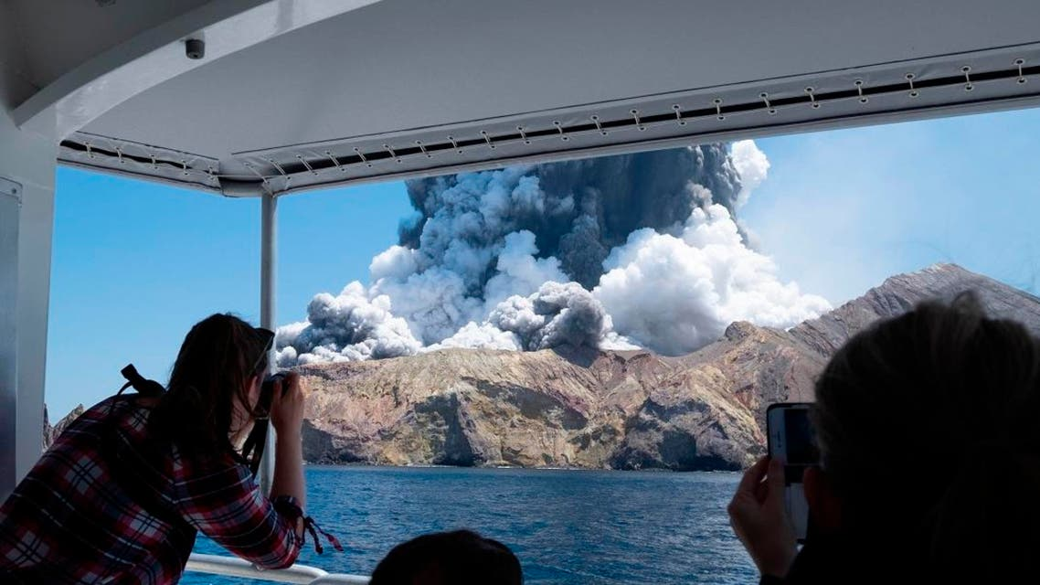 Tourists on a boat look at the eruption of the volcano on White Island, New Zealand. (Photo: AP)