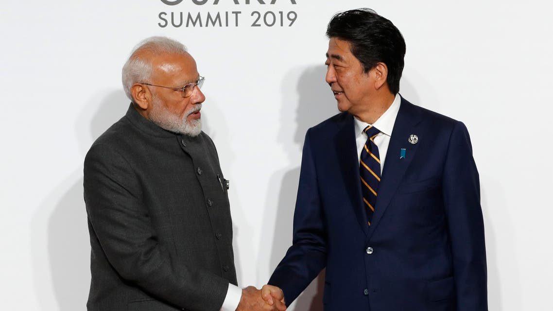 India's Prime Minister Narendra Modi, left, is welcomed by Japanese Prime Minister Shinzo Abe upon his arrival for an welcome and family photo session at G-20 leaders summit in Osaka, Japan, Friday, June 28, 2019. (AP)