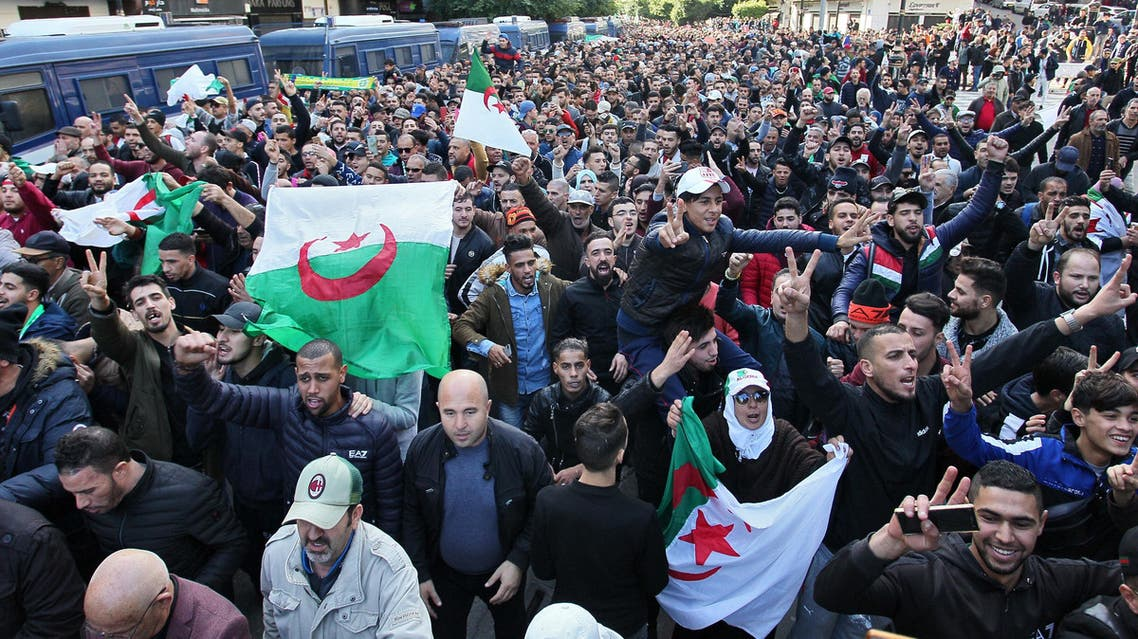 Algerian protesters take part in an anti-government demonstration in the capital Algiers on December 12, 2019 during the presidential election. (AP)
