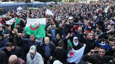 Algerians mass in capital in protest at new president