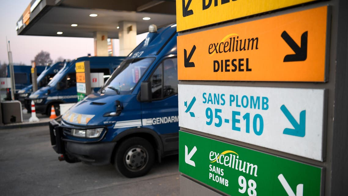 French Gendarmerie trucks are parked in a petrol station close to a fuel depot after its access was cleared by Gendarmes in Vern-sur-Seiche, near Rennes, western France, on December 3, 2019. (AFP)
