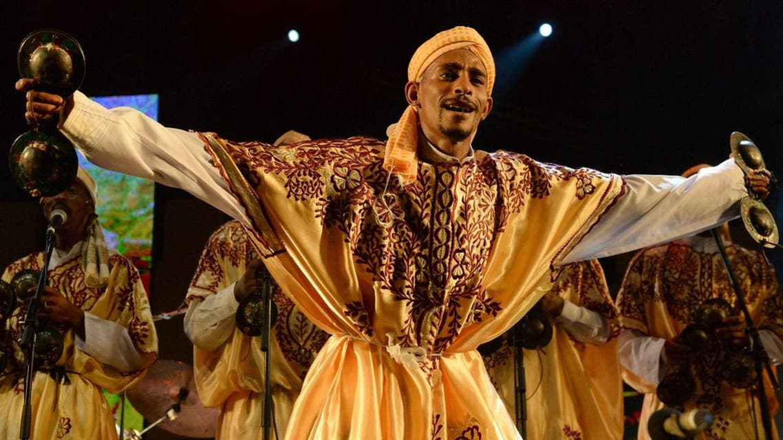 A member of Gnawa group Maalem Mohamed Kouyou performs in Essaouira at the Gnaoua World Music Festival. (File photo: AFP)