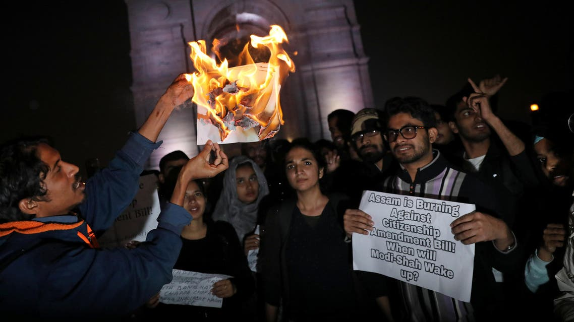 Demonstrators burn a copy of the Citizenship Amendment Bill during a protest in New Delhi on December 12, 2019. (Photo: Reuters)