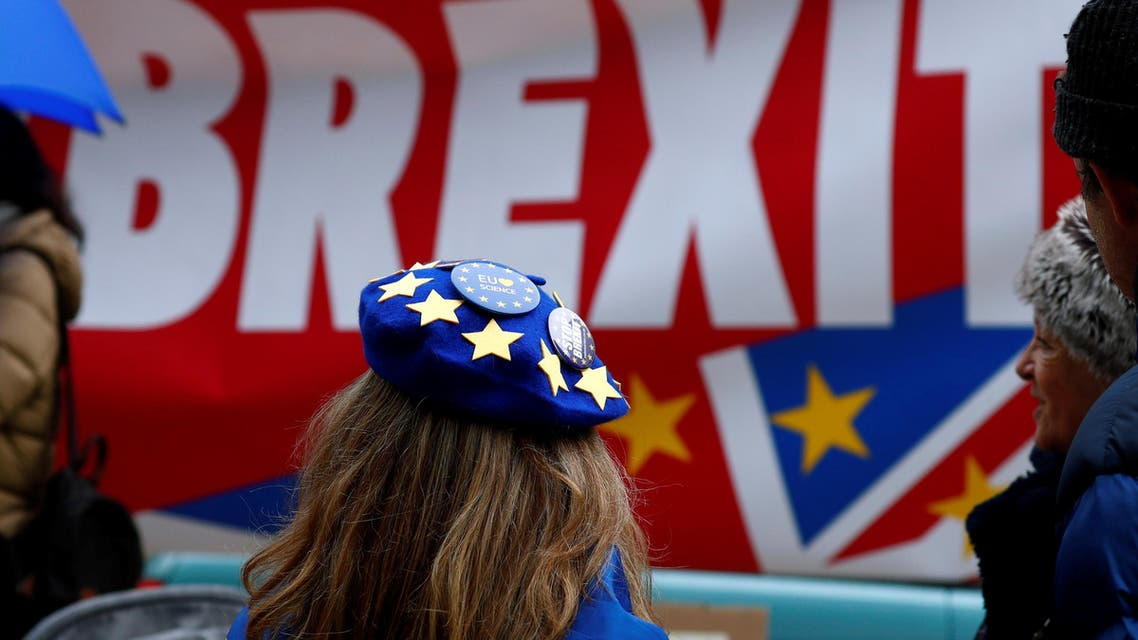 Anti-Brexit badges on a protester's beret are pictured during a demonstration in front of the British embassy in Brussels, Belgium December 5, 2019. REUTERS