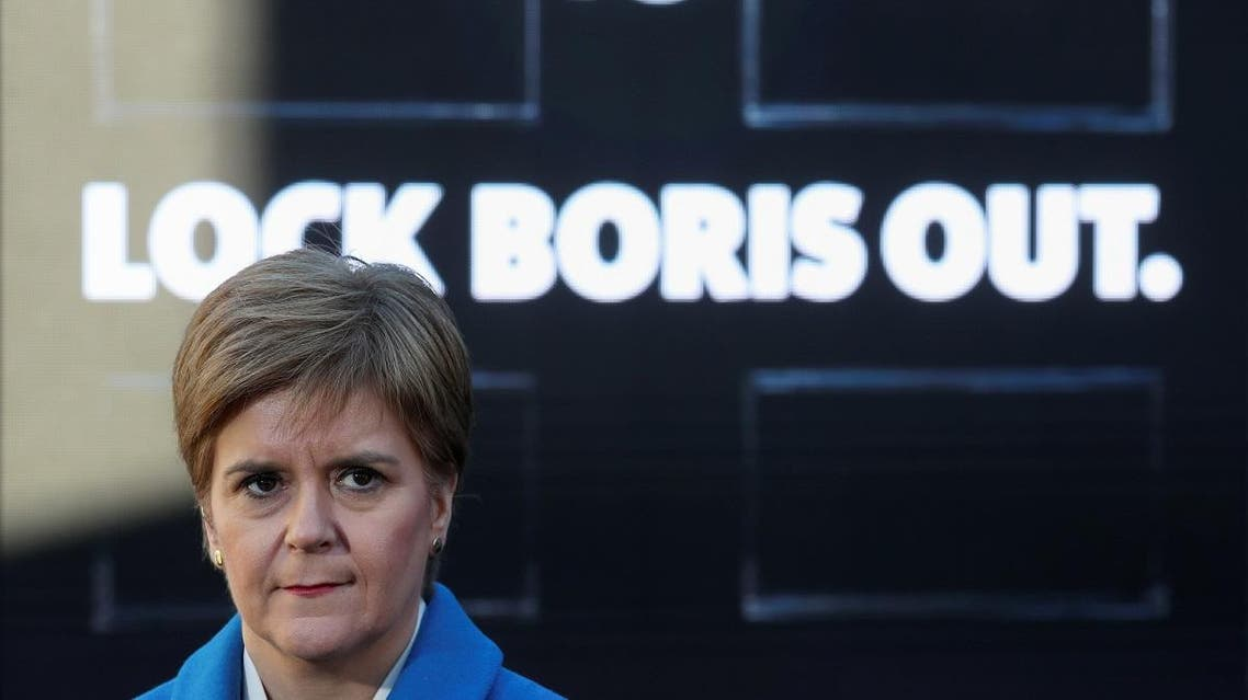 """Leader of the Scottish National Party Nicola Sturgeon attends a """"Lock Boris Out"""" photo opportunity as she campaigns in Coatbridge, Scotland. (Reuters)"""
