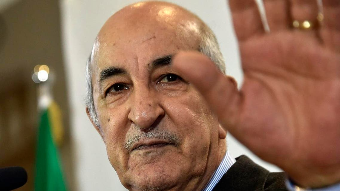 Algerian President-elect Abdelmadjid Tebboune waves to supporters in the capital Algiers. (AFP)