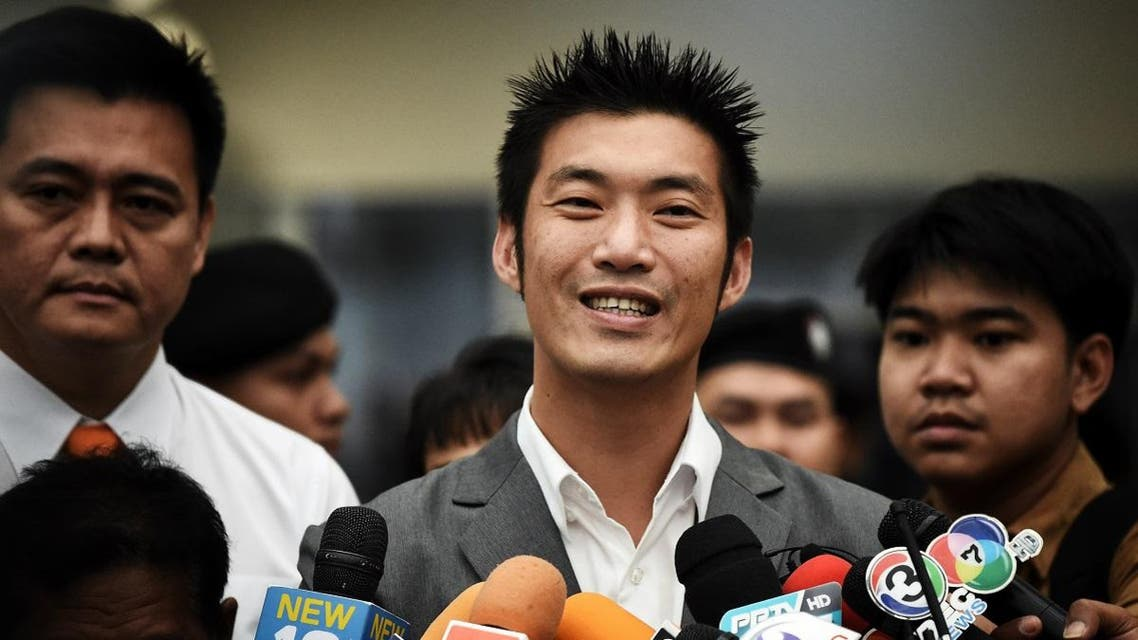 Thanathorn Juangroongruangkit, billionaire leader of opposition Future Forward Party, speaks to the press as he arrives to face his first hearing over disputed media shares at the Constitutional Court in Bangkok on October 18, 2019. (AFP)
