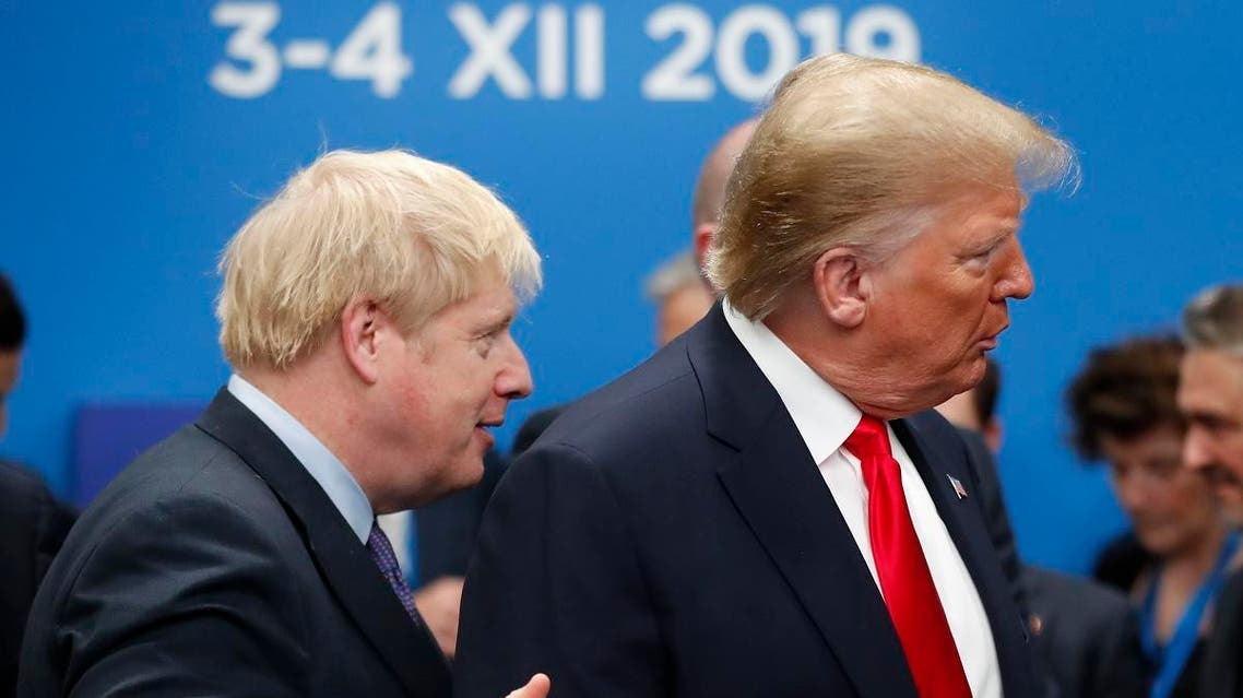 British Prime Minister Boris Johnson walks over to U.S. President Donald Trump who is talking to Canadian Prime Minister Justin Trudeau prior to a NATO leaders meeting. (AP)