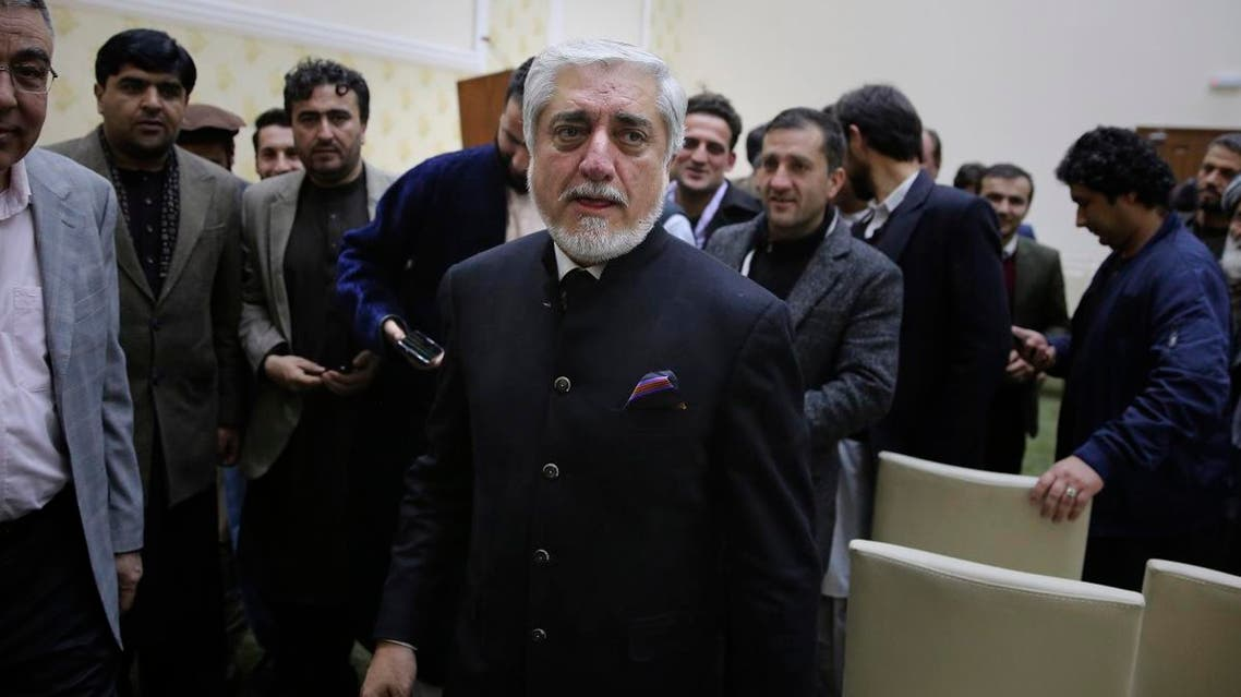 Afghan presidential candidate Abdullah Abdullah, leaves after addressing the media following a conference with his party members and few candidates in Kabul. (AP)