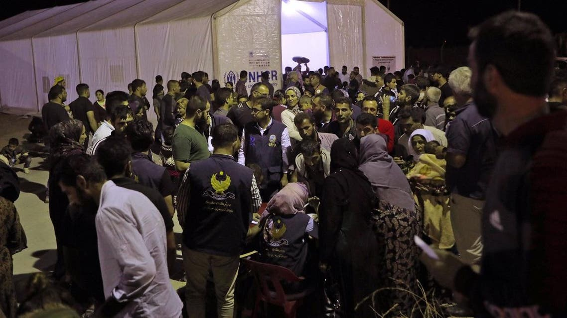 Syrians who have been recently turned refugees by the Turkish military operation in northeastern Syria are pictured upon arriving at the Bardarash camp, near the Kurdish city of Dohuk, in Iraq's autonomous Kurdish region, on October 20, 2019. (AFP)