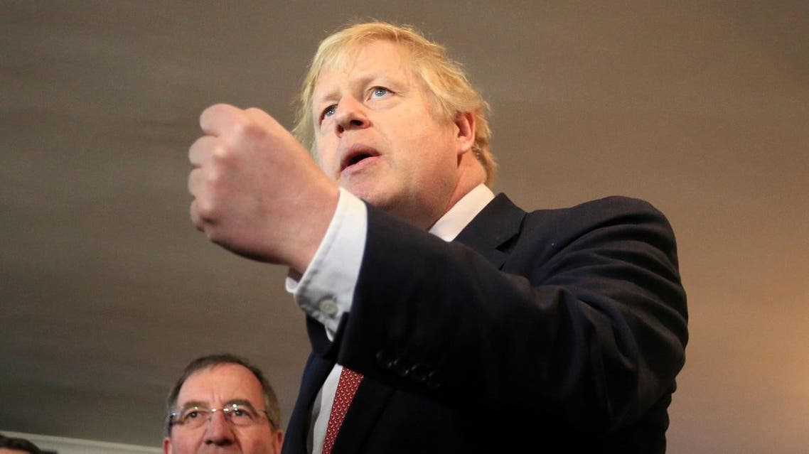 Britain's PM Johnson visits newly elected Conservative party MP for Sedgefield, Paul Howell, at Sedgefield Cricket Club in County Durham. (Reuters)