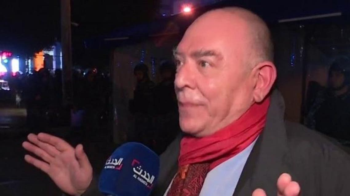 Lebanese activist and political analyst Lokman Slim speaks after the incident at The Hub tent.