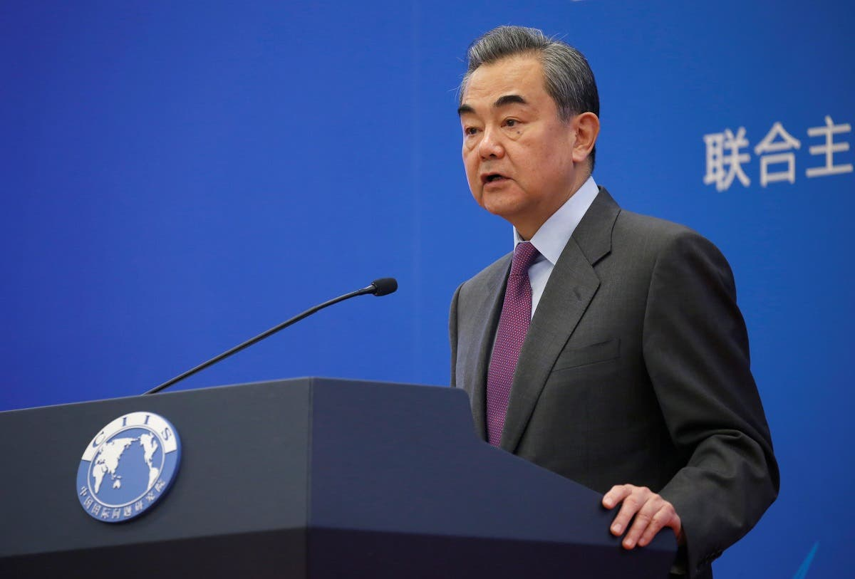 Chinese Foreign Minister Wang Yi delivers a speech at an annual symposium on international situation and China's diplomacy in Beijing. (Reuters)