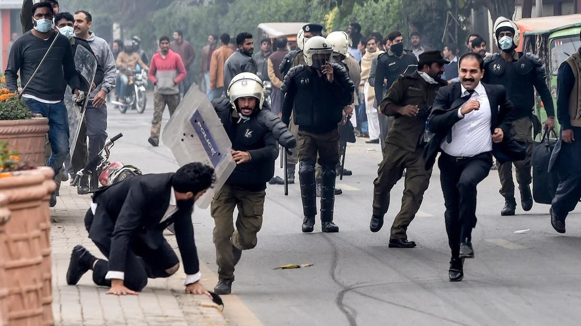 Policemen chase lawyers following a clash between lawyers and doctors in Lahore on December 11, 2019. (AFP)