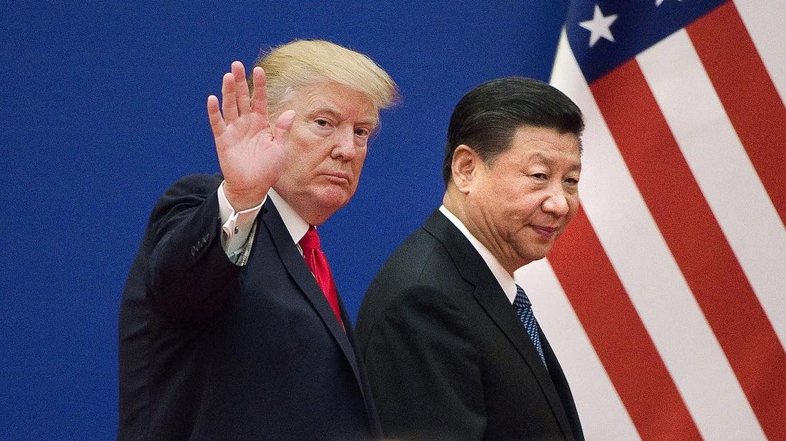 File photo shows US President Donald Trump and China's President Xi Jinping leaving a business leaders event at the Great Hall of the People in Beijing. (AFP)