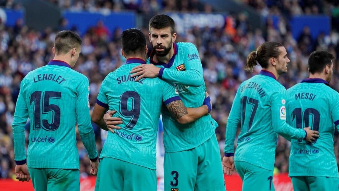 Barcelona's Luis Suarez celebrates scoring their second goal with Gerard Pique. (Reuters)