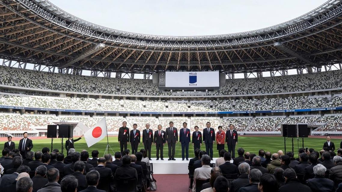 People pose during a group photograph during the construction completion ceremony of the New National Stadium on December 15, 2019 in Tokyo, Japan. (Photo: Reuters)