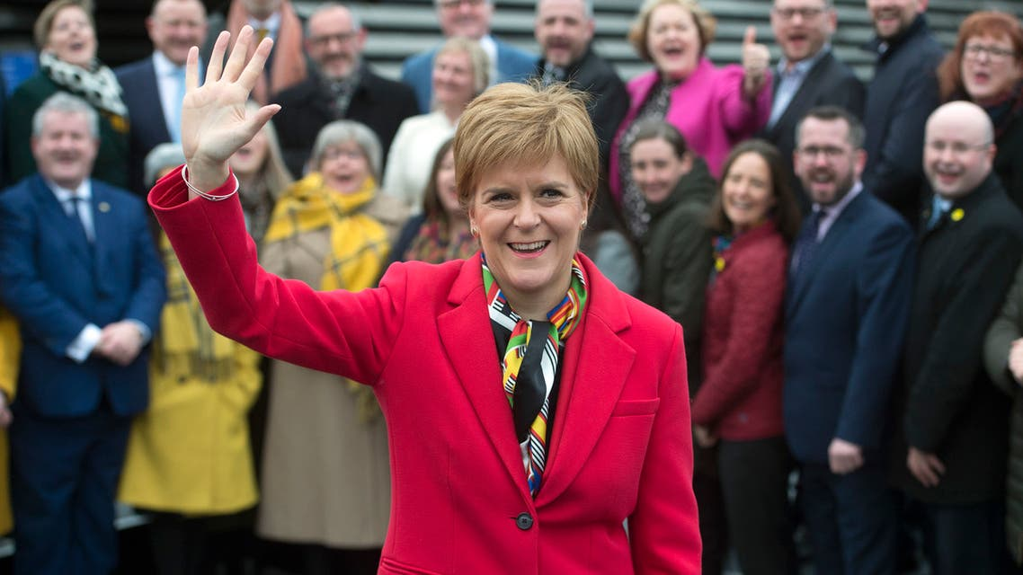 Scottish National Party (SNP) leader and Scotland's First Minister Nicola Sturgeon poses with SNP's newly elected MPs during a photo call outside the V & A Museum in Dundee, Scotland on December 14, 2019.