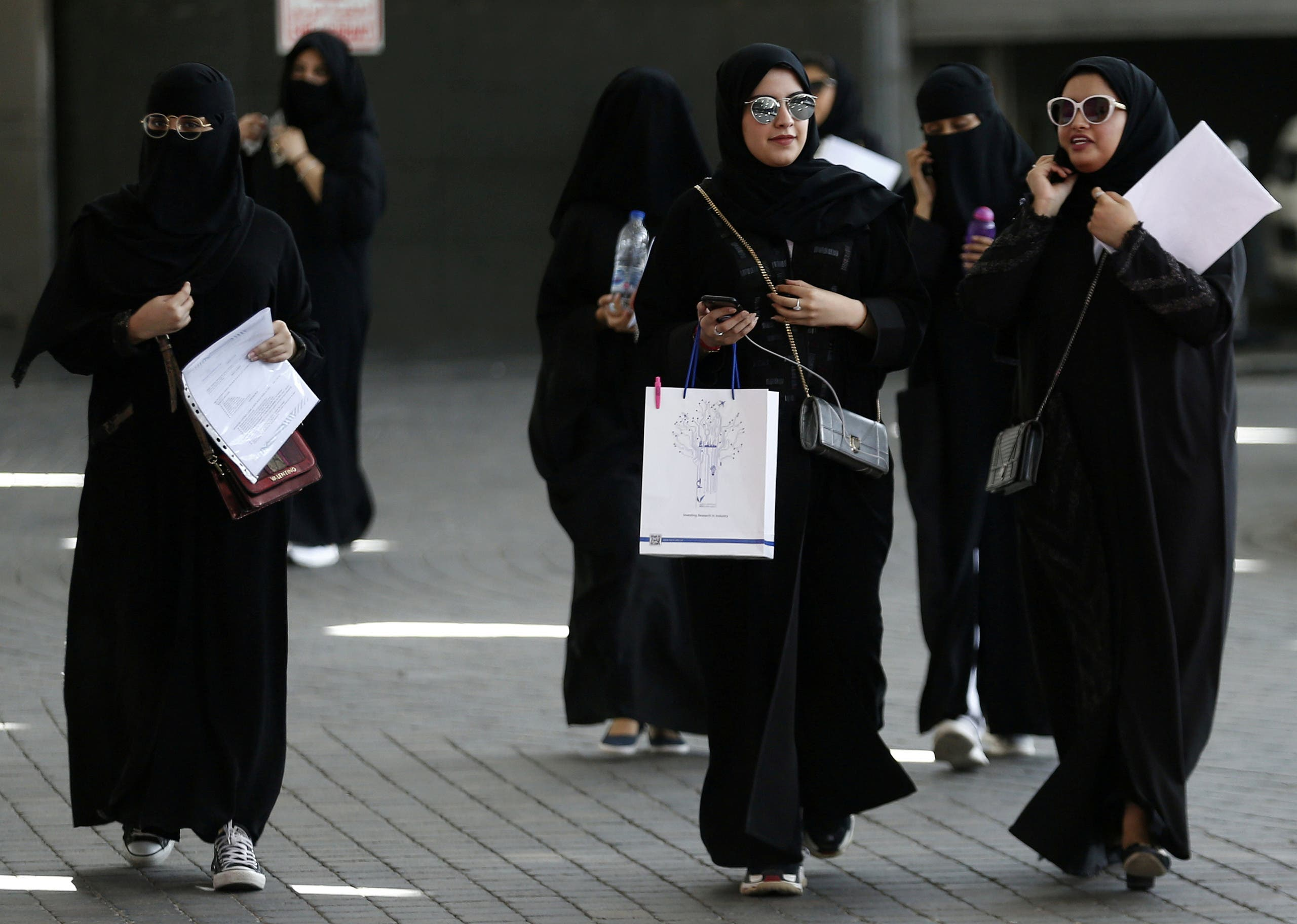 Saudi students walk at the exhibition to guide job seekers. (File photo: Reuters)