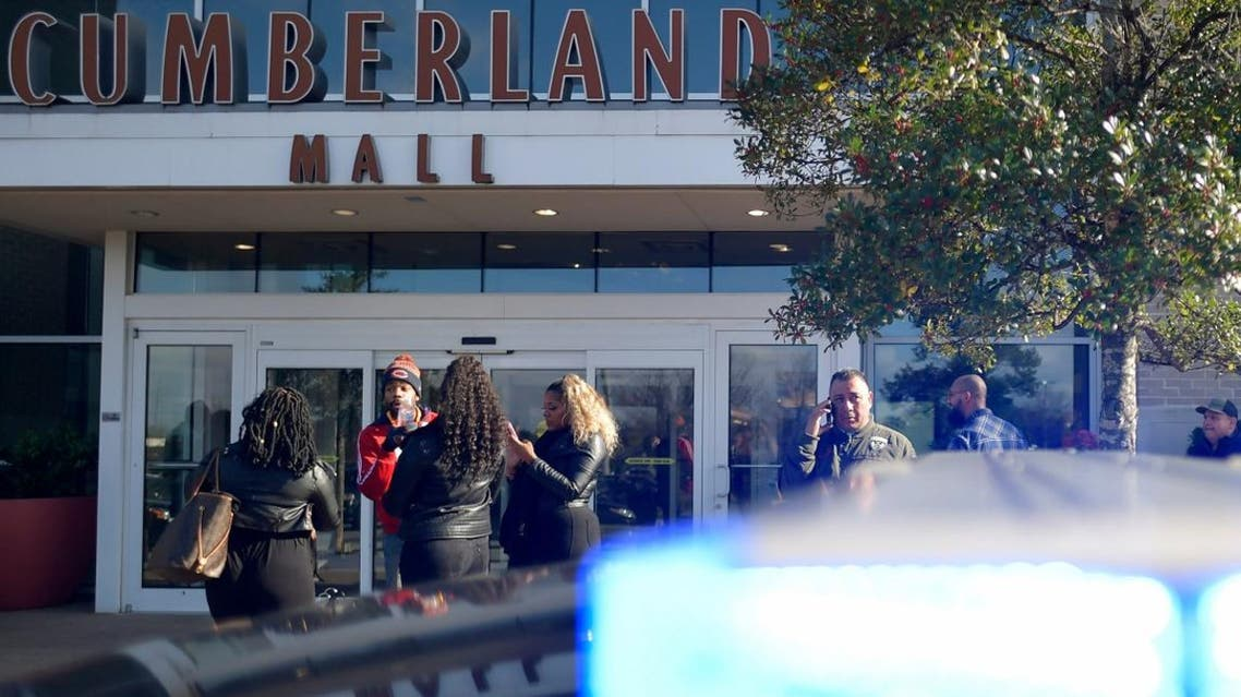 Bystanders wait outside as authorities investigate an incident at Cumberland Mall in Smyrna, Ga., on Saturday, Dec. 14, 2019. (Photo: AP)
