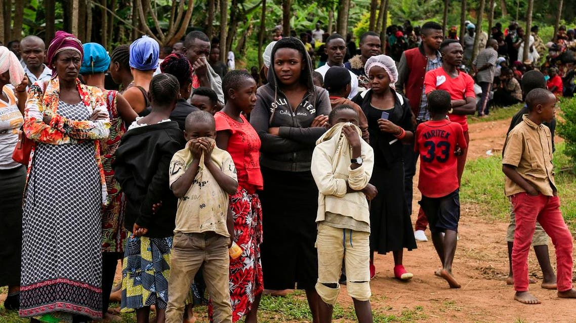 People gather in Oicha, on November 29, 2019, as 27 victims of the latest massacre in DR Congo's volatile east were being buried, with hundreds paying homage while lashing out at security forces for failing to stop attacks. (AFP)