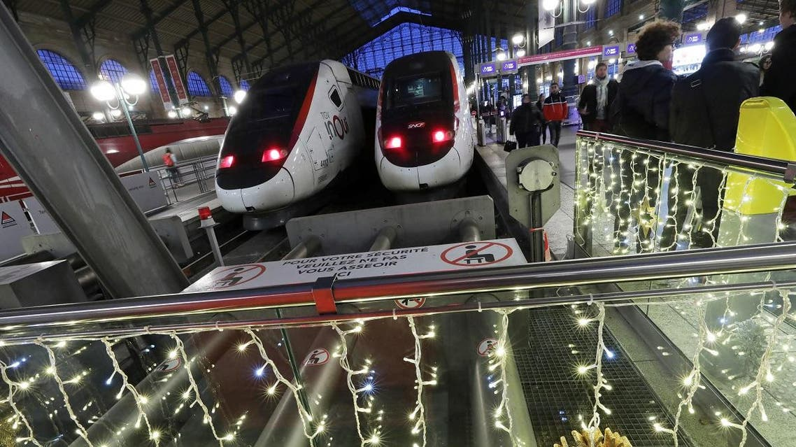 TGV trains are pictured behind Christmas decorations at Gare du Nord train station during a strike by unions. (Reuters)