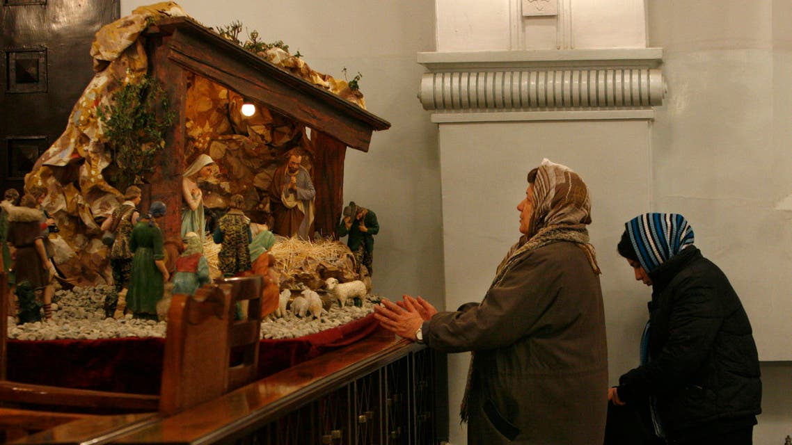 Iranian Christian women pray during a Christmas Eve mass at the St. Grigor Armenian Catholic church in Tehran, Iran, Wednesday, Dec. 24, 2008. (AP)