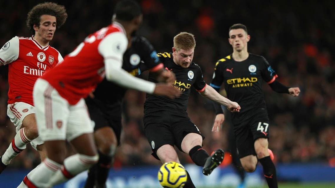 Manchester City's Kevin De Bruyne (second right), scores his side's third goal during the English Premier League soccer match at the Emirates Stadium in London, on December 15, 2019. (AP)